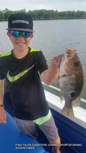 Connor and his fingermark while estuary fishing in Trinity Inlet, Cairns 28th January 2018
