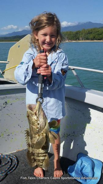 Lilly and her Gold Spot Estuary Cod while fishing at Palmer Point