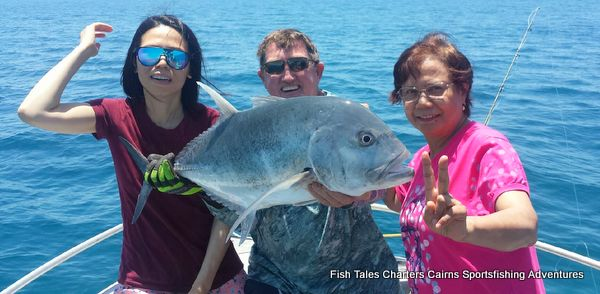 Sam, Chen and Barry with their Giant Trevally