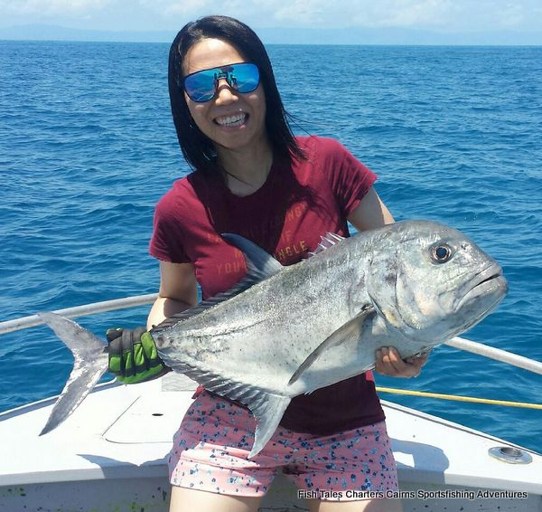 Sam and her Giant Trevally on poppers